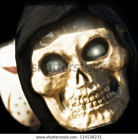 Grim Reaper in the Shadows - stock photo