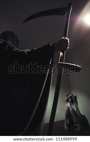 Grim reaper menace a young woman scared - stock photo
