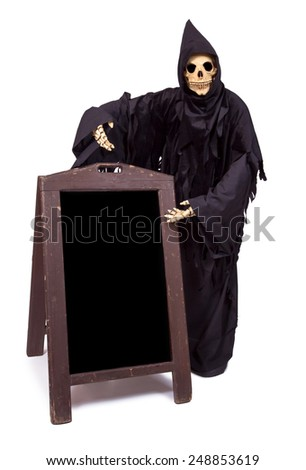 Grim Reaper offers a choice of menu - stock photo
