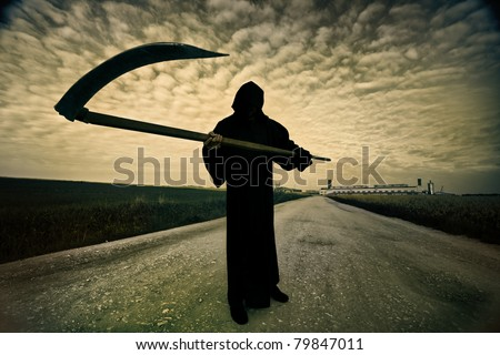 Grim Reaper on the road - stock photo