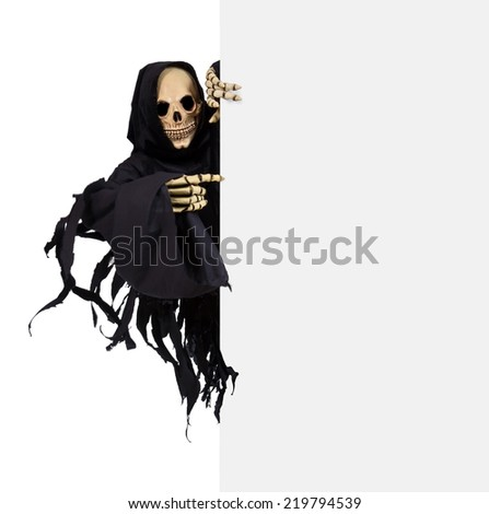 Grim Reaper pointing the finger at a blank panel - stock photo