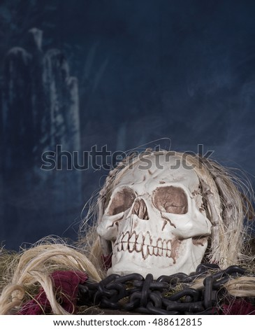 Grim reaper skull in a halloween background