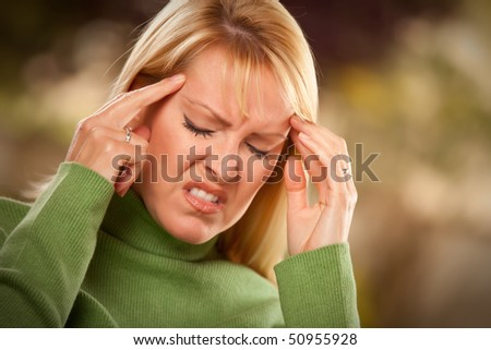 Grimacing Woman Suffering a Painful Headache. - stock photo