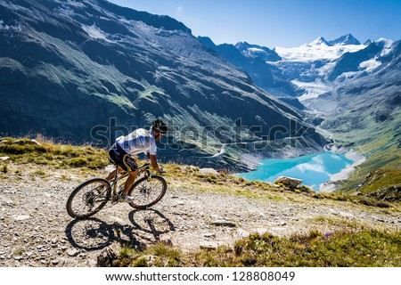 GRIMENTZ, SWITZERLAND � AUGUST 20: An unidentified rider in the Grand Raid winds his way from Verbier to Grimentz August 20, 2011. The event's 24th edition will be held on the 23 & 24 august 2013. - stock photo