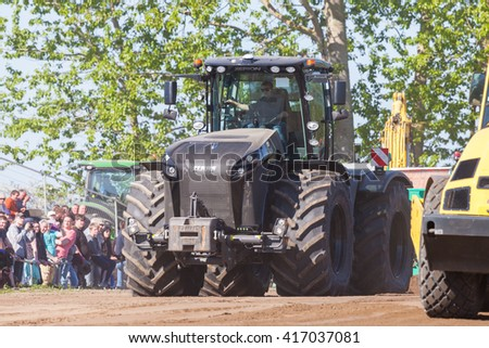 GRIMMEN/ GERMANY - MAY 5: german claas xerion tractor drives on track on a motortechnic festival on may 5, 2016 in grimmen / Germany.