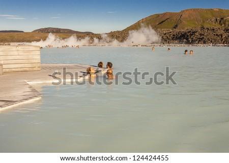 GRINDAVIK, ICELAND - JULY 8: Tourist at Blue Lagoon on July 8, 2010 in Grindavik. Blue Lagoon is most popular spa resort in Iceland. - stock photo