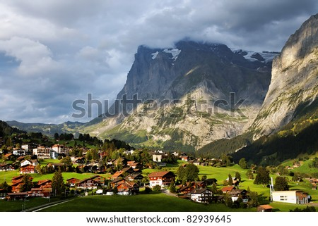 Grindelwald Village and Wetterhorn Peak, Switzerland - stock photo