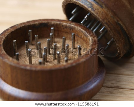 Grinder marijuana detail. The photo shows a macro photo oof a wooden grinder