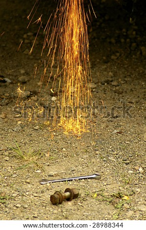 Grinder sparks falling to the ground - stock photo