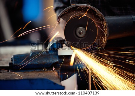 Grinding metal - stock photo