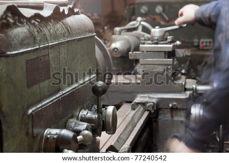 Grinding process. Metal industrial machines and tools - stock photo