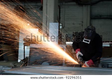 grinding sparks in a heavy industry workshop - stock photo