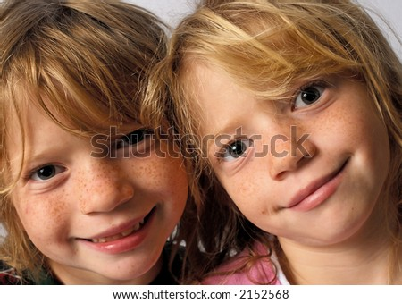 Grinning Twins, Headshot - stock photo