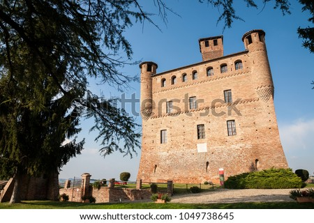 Grinzane Cavour, Italy - 2016, September 27 : The red brick castle of Grinzane Cavour in the Barolo Langhe area of the Piemonte region of northern Italy