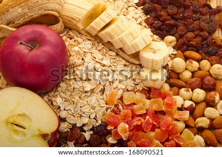 grits with apples, bananas, raisins, candied fruit and nuts - stock photo