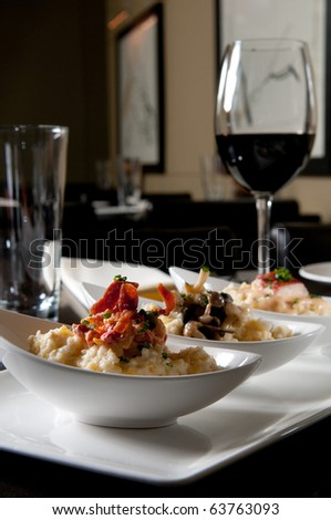 Grits with bacon, mushroom, and lobster - stock photo