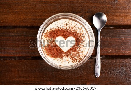 Grits with cocoa heart on top - stock photo