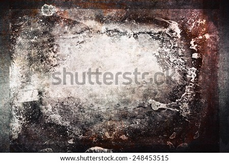 Gritty dark background with faded light center for copy space. - stock photo