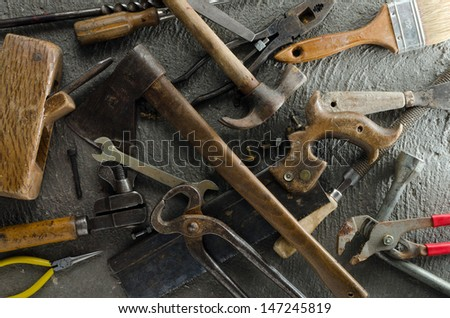 Gritty hand tools and other bits of grungy hardware - stock photo
