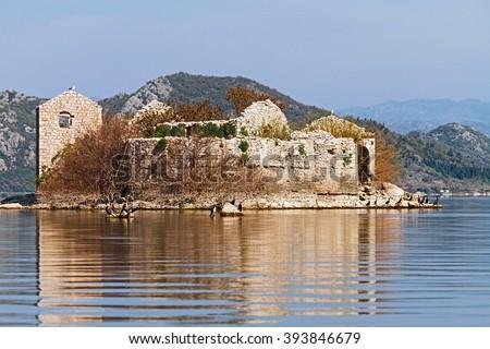 Grmozur old prison island on Lake Skadar, Montenegro. - stock photo