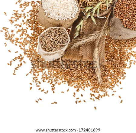groats seed meal and grains in bags close up corner border  isolated on a white background  - stock photo