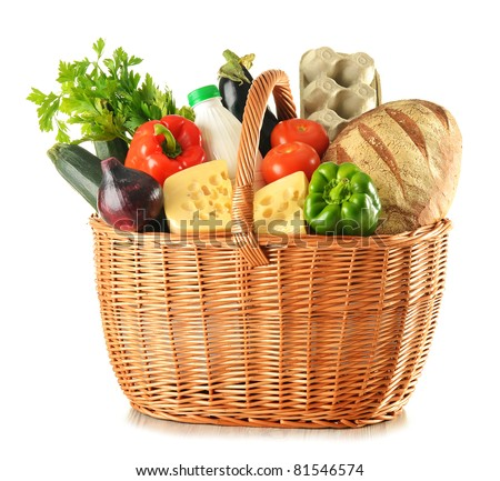 Groceries in large wicker basket isolated on white - stock photo