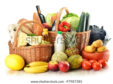 Groceries in wicker baskets isolated on white. Fresh vegetables, fruits, dairy and bakery products and wine. - stock photo
