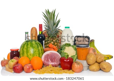 Groceries studio shot of fresh food and drink isolated on a white background, including fruit, vegetables, meat, sauces, pizza, wine and dairy products. - stock photo
