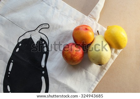 Grocery bag and fruits - stock photo
