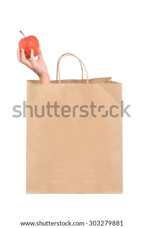 grocery bag with hand holding an apple isolated on white background - stock photo