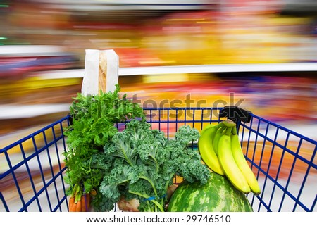 grocery cart filled with healthy food - stock photo