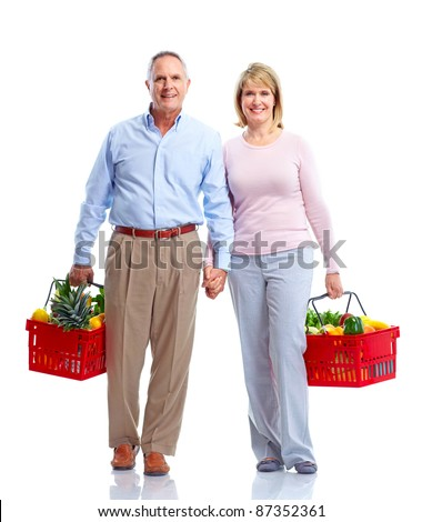 Grocery. Happy senior couple with a shopping basket . - stock photo