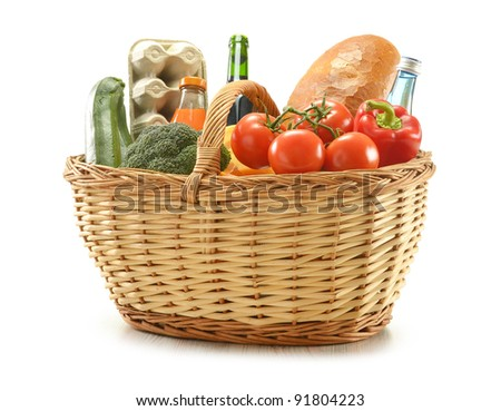 Grocery in wicker basket isolated on white - stock photo
