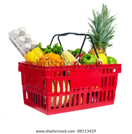 Grocery shopping basket with food. - stock photo