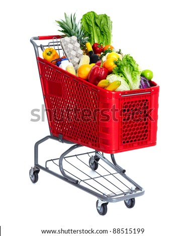 Grocery shopping cart with food. Isolated over white background. - stock photo