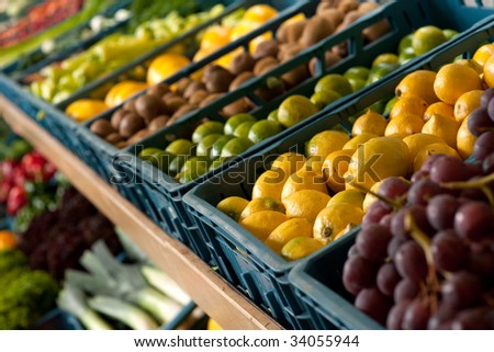 Grocery store - Boxes with fruits, focus on lemon