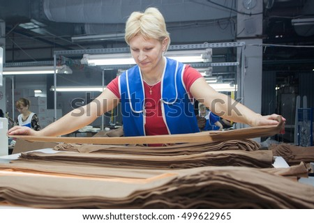 GRODNO, BELARUS - DECEMBER 13, 2013: women at factory on production of panty hoses .