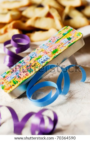Grogger and Hamantaschen cookies for Jewish Festival of Purim - stock photo