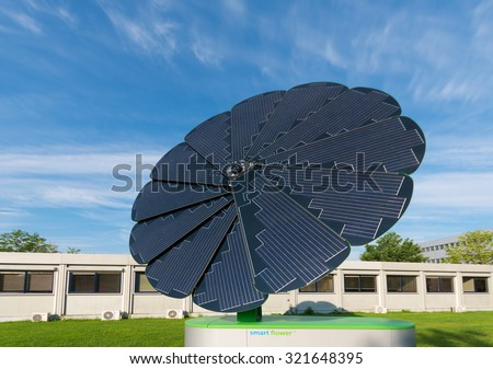 GRONINGEN, NETHERLANDS - AUGUST 22, 2015: Smart Flower solar collector on the groningen university area. The foldable collector completely powers the exterior lighting of the campus sports center - stock photo
