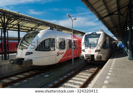 GRONINGEN, NETHERLANDS - AUGUST 22, 2015: Train platform at the groningen central train station. This station is the main railway hub of the northeastern part of the country - stock photo