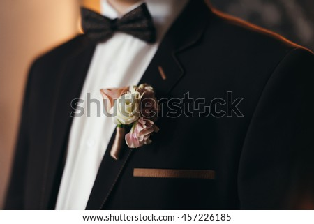 Groom Accessories: Butterfly and boutonniere
