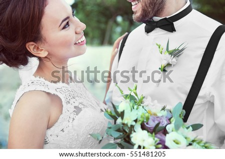 Groom and bride at romantic moment outdoors