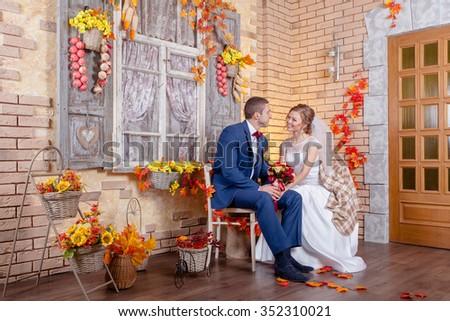 groom and bride autumn wedding ceremony - stock photo