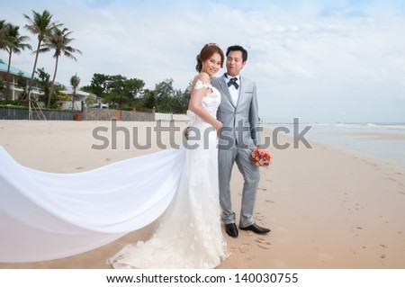 groom and bride embrace