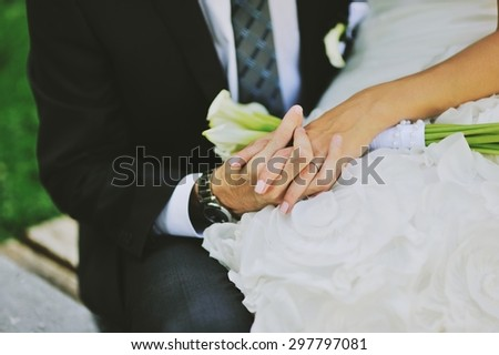 Groom and bride holding hands. Wedding  couple together. - stock photo