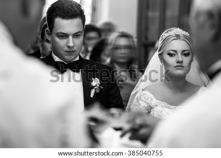 Groom and bride on the wedding ceremony in the church - stock photo