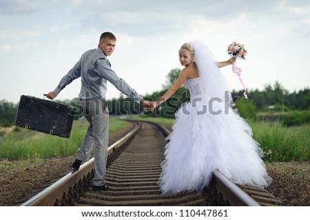 Groom and Bride. Wedding dress. Bridal wedding bouquet of flowers - stock photo