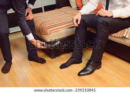 groom and groomsman preparing for wedding - stock photo