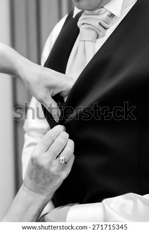 groom buttons white shirt - stock photo