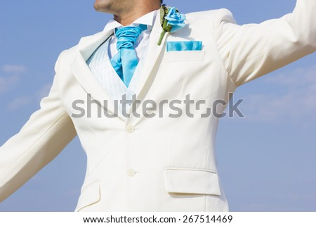 Groom by the sea on his wedding day